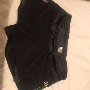 Zoot black exercise shorts with built-in lining.